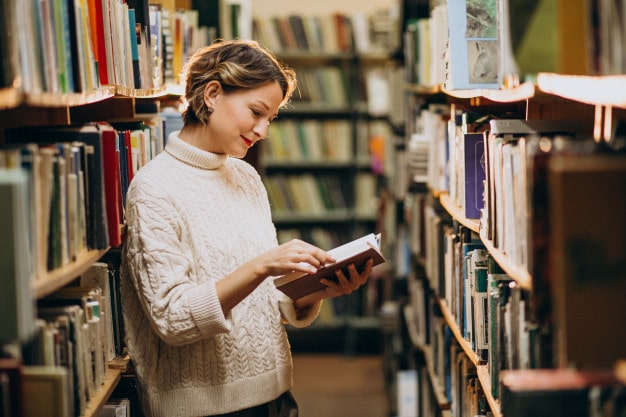 young woman studying library